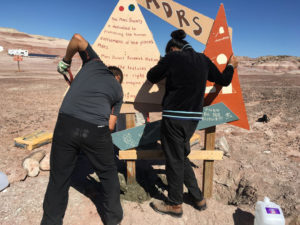 Yusuke and Anushree installing the MDRS sign