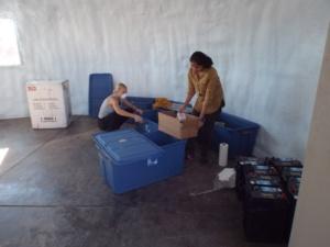 Anastasiya and Anushree cleaning and unpacking the science dome