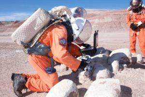 jon-clarke-trying-out-the-geological-hammer-split-alex-standing-by-jpg