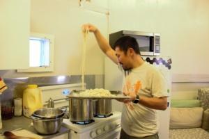 Yusuke cooking udon