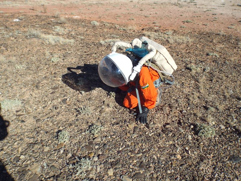 Anushree examining a Fremont gravel terrace for hypoliths during an EVA.