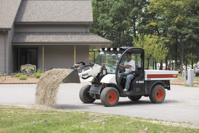ToolCat light vehicle with earth moving attachments (Bobcat).