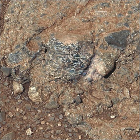 Granite pebbles in a conglomerate imaged by the Curiosity rover mission on the floor of Gale Crater (NASA image).